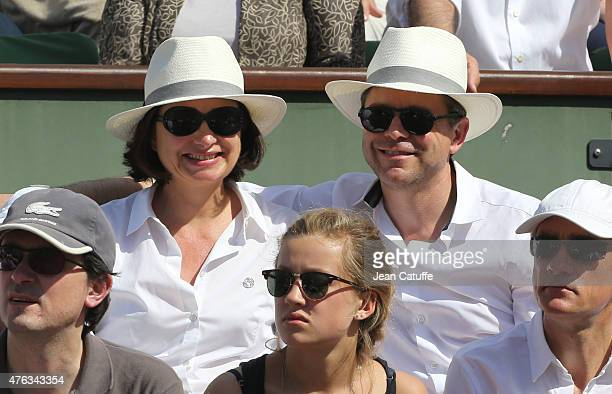 Guillaume de Tonquedec and his wife Christelle de Tonquedec attend the men's final on day 15 of the French Open 2015 at Roland Garros stadium on June...