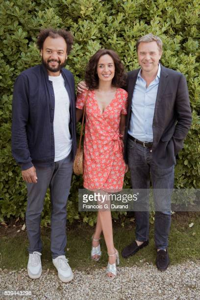 Guillaume de Tonquedec Fabrice Eboue and Amelle Chahbi attend the 10th Angouleme FrenchSpeaking Film Festival on August 26 2017 in Angouleme France