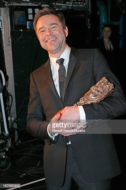 Guillaume de Tonquedec poses backstage with his Cesar award for best supporting actor during the Cesar Film Awards 2013 at Theatre du Chatelet on...