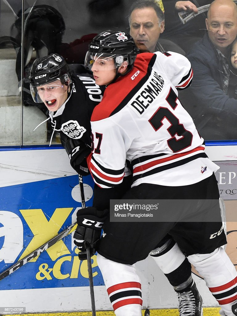 Guillaume Desmarais #37 of the Drummondville Voltigeurs pins Maxime Collin #9 of the Blainville-Boisbriand Armada against the boards during the QMJHL game at Centre d'Excellence Sports Rousseau on October 27, 2017 in Boisbriand, Quebec, Canada.