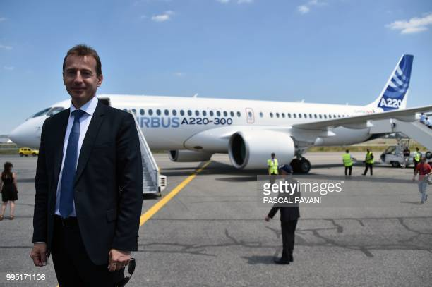 Guillaume Faury President of the Airbus Commercial Aircraft poses in front of the new Airbus A220300 during its presentation on July 10 2018 at the...