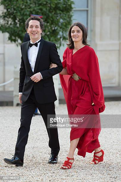 Guillaume Gallienne and Amandine Gallienne arrive at the Elysee Palace for a State dinner in honor of Queen Elizabeth II hosted by French President...