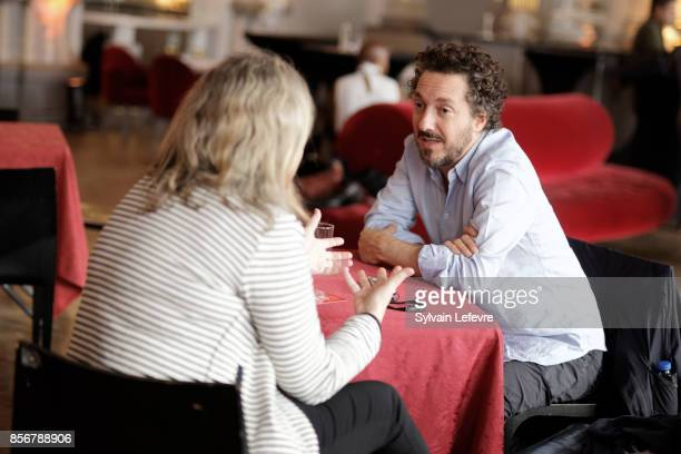 Guillaume Gallienne speaks with a reporter during 32nd Namur International FrenchLanguage Film on October 2 2017 in Namur Belgium