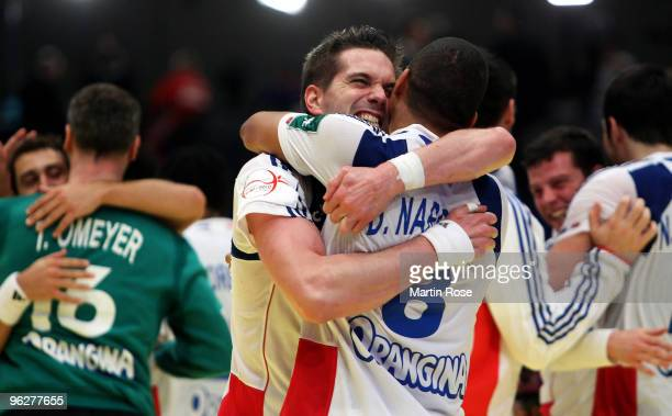 Guillaume Gille of France celebrates with team mate Daniel Narciss after the Men's Handball European semi final match between Iceland and France at...