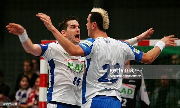 Guillaume Gille of Hamburg celebrates with his team mate Pascal Hens during the Handball DHB German Cup game between HSV Handball and SC Magdeburg at...