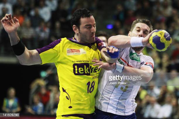 Guillaume Gille of Hamburg is challenged by Iker Romero of Berlin during the EHF Champions League round of sixteen match between Fuechse Berlin and...