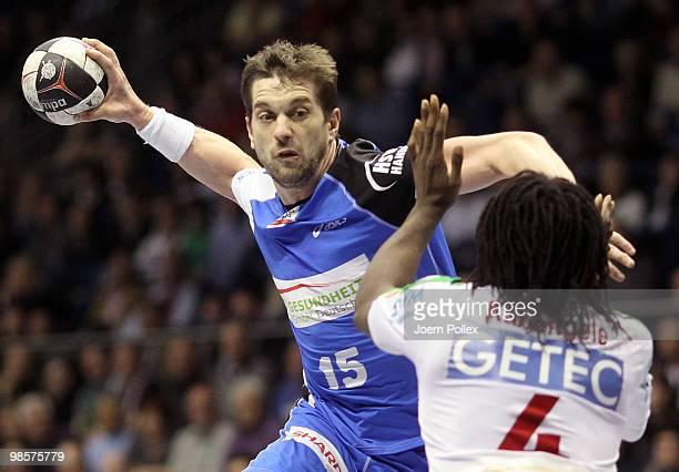 Guillaume Gille of Hamburg scores during the Toyota Handball Bundesliga match between SC Magdeburg and HSV Hamburg at the Boerdeland Hall on April 20...