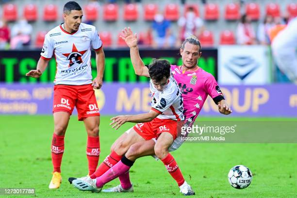 Guillaume Gillet of Charleroi battles for the ball with Jannes Van Hecke of Zulte during the Jupiler Pro League match between SV Zulte Waregem and...