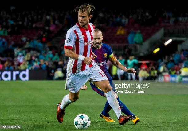 Guillaume Gillet of Olympiacos FC fights for the ball with Andres Iniesta Lujan of FC Barcelona during the UEFA Champions League 2017-18 match...