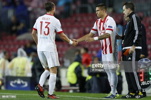 Guillaume Gillet of Olympiacos, Uros Djurdjevic of Olympiacos during the UEFA Champions League group D match between FC Barcelona and Olympiacos on...