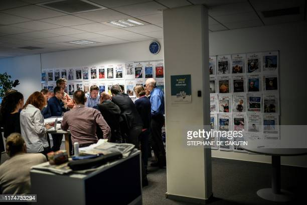 "Guillaume Goubert , chief executive officer and director of French daily newspaper "" La Croix "", attends the editorial meeting at the headquarter in..."