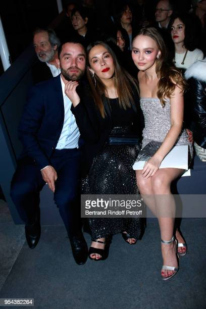 Guillaume Gouix Alysson Paradis and her niece LilyRose Depp attend the Chanel Cruise 2018/2019 Collection Front Row at Le Grand Palais on May 3 2018...