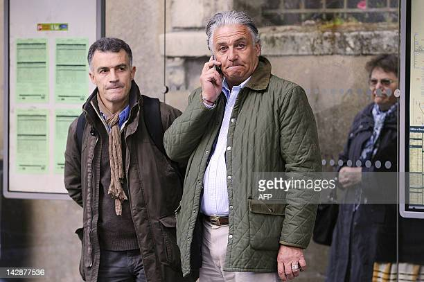 Guillaume Hodanger one of the Xavier Dupont de Ligonnes' brothers speaks on the phone prior to take part in a silent march on April 14 2012 in the...
