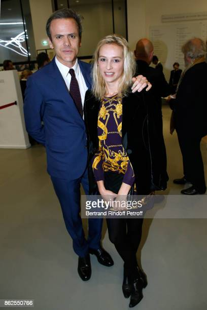 Guillaume Houze and guest attend the Societe des Amis du Musee d'Art Moderne de la Ville de Paris Dinner on October 17 2017 in Paris France