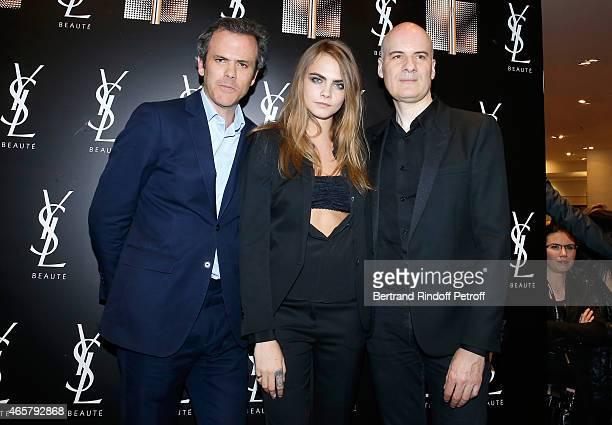 Guillaume Houze Cara Delevigne and Stephan Bezy attend the Yves Saint Laurent Beauty at Galeries Lafayette on March 10 2015 in Paris France