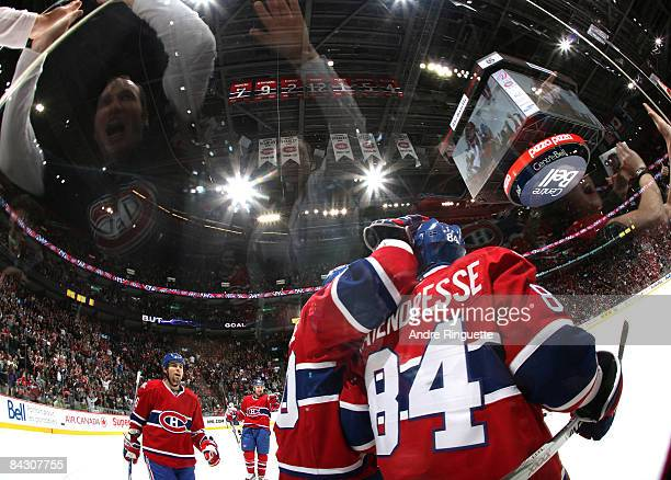 Guillaume Latendresse of the Montreal Canadiens celebrates his first period goal against the Nashville Predators with teammates and fans at the Bell...