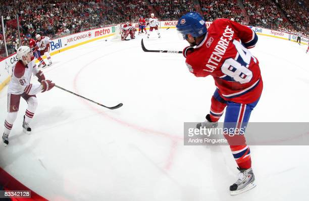 Guillaume Latendresse of the Montreal Canadiens fires a shot against the Phoenix Coyotes' net at the Bell Centre on October 18 2008 in Montreal...