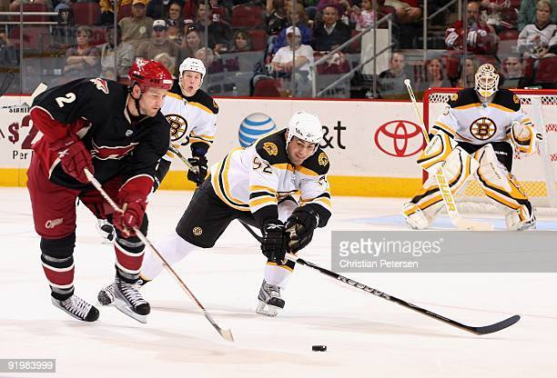 Guillaume Lefebvre of the Boston Bruins defends against Jim Vandermeer of the Phoenix Coyotes during the NHL game at Jobingcom Arena on October 17...