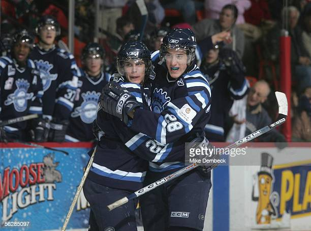 Guillaume Lepine and LouisEtienne Leblanc of the Chicoutimi Sagueneens celebrate after scoring against the Halifax Mooseheads during the game at the...