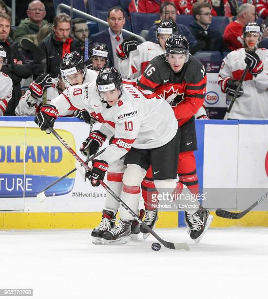 Guillaume Maillard of Switzerland skates the puck past Taylor Raddysh of Canada during the first period of play in the Quarterfinal IIHF World Junior...