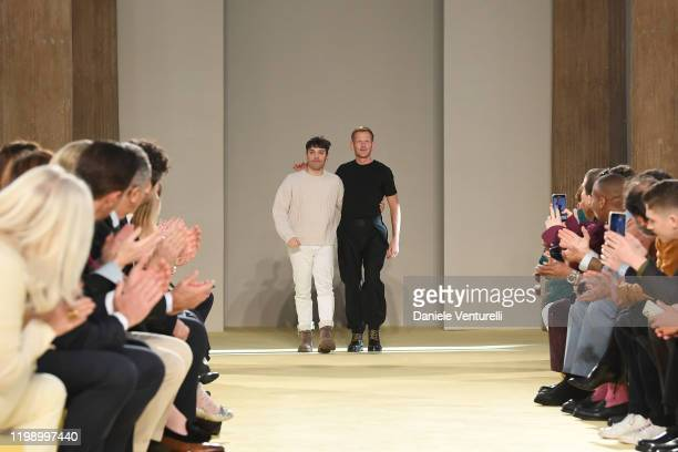 Guillaume Meilland and Paul Andrew acknowledge the applause of the audience after the Salvatore Ferragamo fashion show on January 12 2020 in Milan...