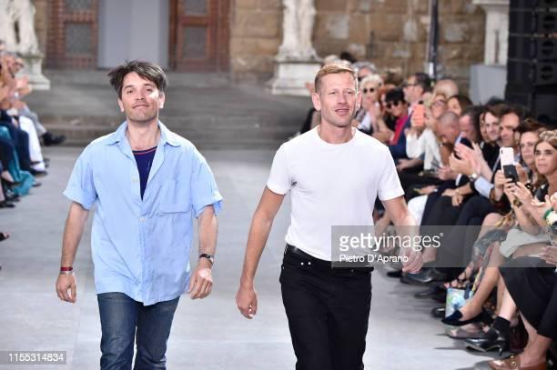 Guillaume Meilland and Paul Andrew acknowledge the audience at the end o the Salvatore Ferragamo fashion show in Piazza della Signoria during Pitti...