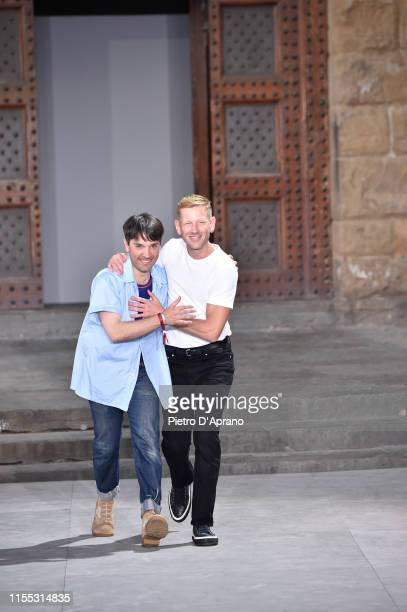 Guillaume Meilland and Paul Andrew acknowledge the audience at the end o the Salvatore Ferragamo fashion show in Piazza della Signoria during Pitti...