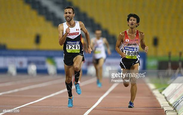 Guillaume Ouellet of Canada wins the men's 5000m T13 final during the Evening Session on Day Eight of the IPC Athletics World Championships at Suhaim...