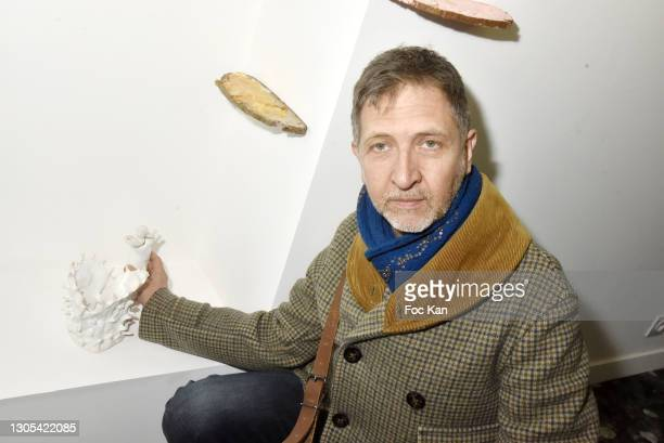 """Guillaume Pinard poses with his work during """"Ils Ont Dit Oui"""" Exhibition an Amalteo Institute Project Curated by Marc Molk at Galerie Marguerite..."""