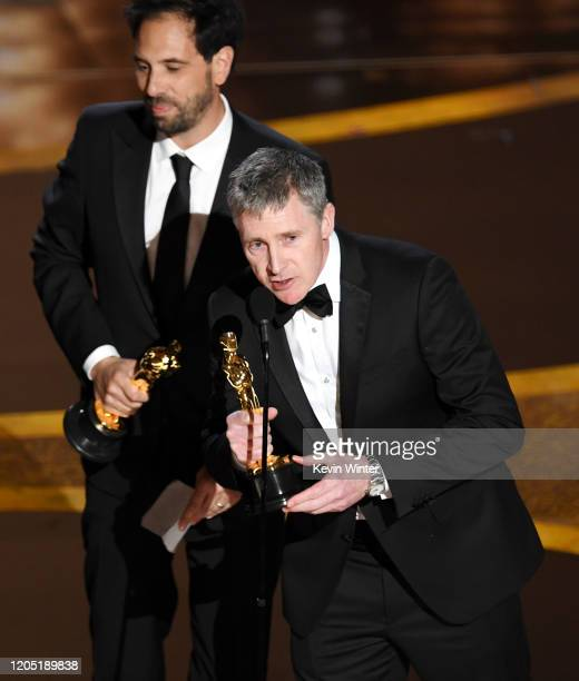 Guillaume Rocheron and Dominic Tuohy accept the Visual Effects award for '1917' onstage during the 92nd Annual Academy Awards at Dolby Theatre on...
