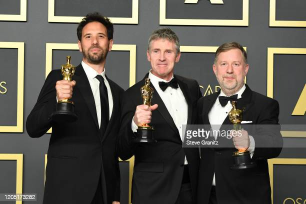 "Guillaume Rocheron, Dominic Tuohy and Greg Butler, winners of the Visual Effects award for ""1917,"" pose in the press room during the 92nd Annual..."