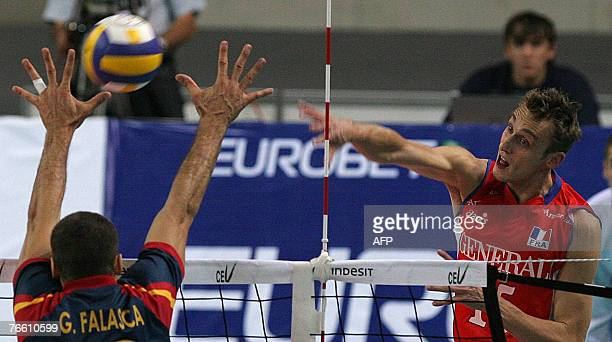 Guillaume Samica of France hits a ball as Guillermo Falasca blocks during their 2007 Men's European Championships qualification match in StPetersburg...