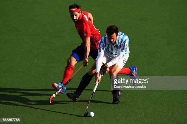 Guillem Fustagueras of Club Egara battles for the ball with Guido Barreiros of Mannheimer HC during the Euro Hockey League KO16 match between...