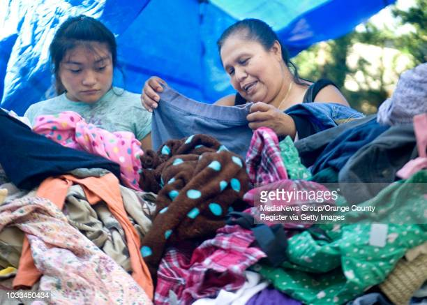 Guillermima Sarabia and her daughter Leidi sort through clothing available at the Southwest Community Center in Santa Ana ///ADDITIONAL INFO Photo by...