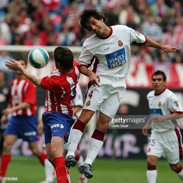 Guillermo Ariel Pereyra of Mallorca challenges Mista of Atletico Madrid during the Primera Liga match between Atletico Madrid and Mallorca at the...