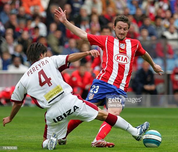 Guillermo Ariel Pereyra of Mallorca tackles Mista of Atletico Madrid during the Primera Liga match between Atletico Madrid and Mallorca at the...
