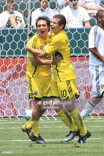 Guillermo Barros Schelotto and Alejandro Moreno of the Columbus Crew celebrate scoring a goal against the Los Angeles Galaxy during their MLS game at...