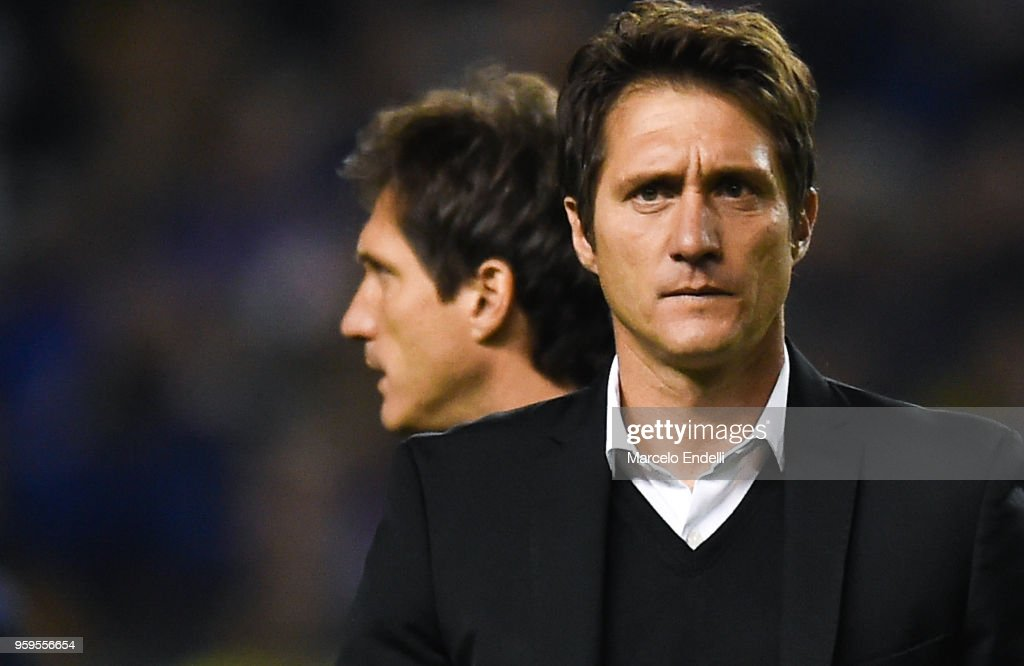 Guillermo Barros Schelotto coach of Boca Juniors and assistant Gustavo Barros Schelotto look on during a match between Boca Juniors and Alianza Lima at Alberto J. Armando Stadium on May 16, 2018 in La Boca, Argentina.