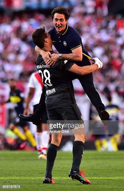Guillermo Barros Schelotto coach of Boca Juniors celebrates with Axel Werner goalkeeper of Boca Juniors after Carlos Tevez scored the third goal of...