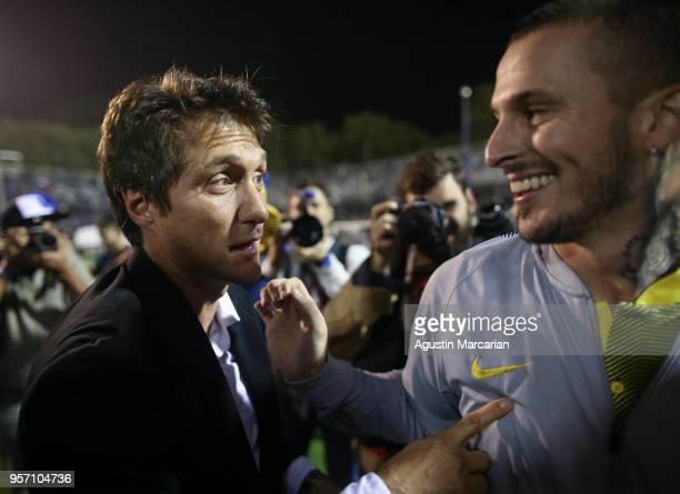 Guillermo Barros Schelotto coach of Boca Juniors celebrates with Dario Benedetto after winning the Superliga 2017/18 at Estadio Juan Carmelo Zerillo...