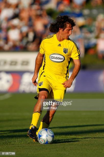 Guillermo Barros Schelotto of the Columbus Crew dribbles against the Kansas City Wizards during the game at Community America Ballpark on June 14...