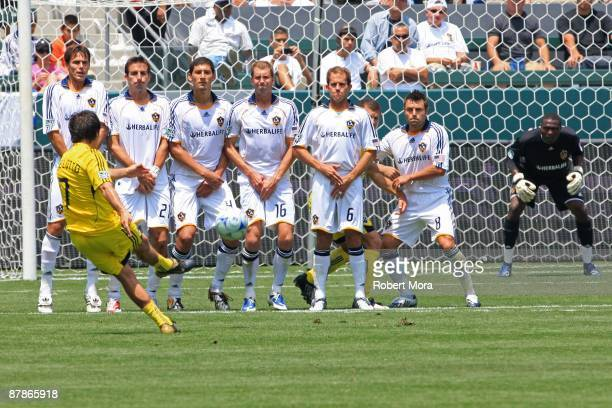 Guillermo Barros Schelotto of the Columbus Crew takes a free kick against a wall of Los Angeles Galaxy defenders during their MLS game at The Home...