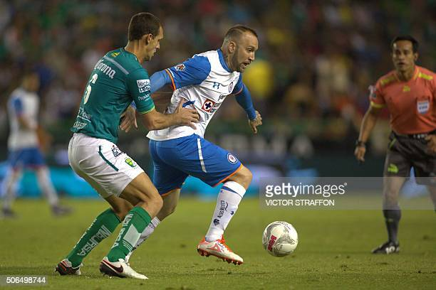 Guillermo Burdisso of Leon vies for the ball with Matias Vuoso of Cruz Azul during their Mexican Clausura tournament football match at the Nou Camp...