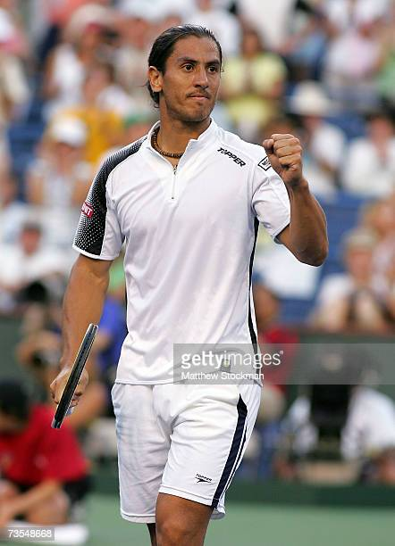 Guillermo Canas of Argentina celebrates after his victory against Roger Federer of Switzerland during the Pacific Life Open on March 11, 2007 at the...