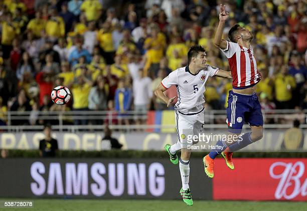 Guillermo Celis of Colombia puches Bruno Valdez of Paraguay in the back on a head ball during the first half of a 2016 Copa America Centenario Group...
