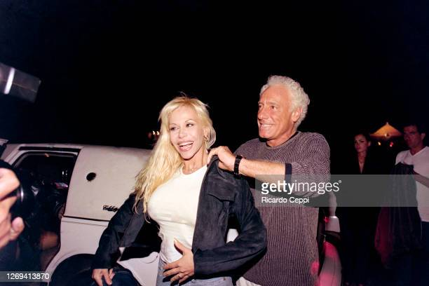 Guillermo Coppola agent of Diego Maradona arrives in a limousine with the celebrity Alejandra Pradon to a party at Conrad Hotel on January 08, 1999...