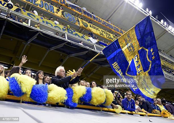 Guillermo Coppola waves a flag next to cheerleaders before the start of the Copa Libertadores 2015 round before the quarterfinals second leg football...