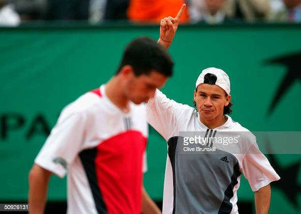 Guillermo Coria of Argentina celebrates after winning his semi final match against Tim Henman of Great Britain during Day Twelve of the 2004 French...