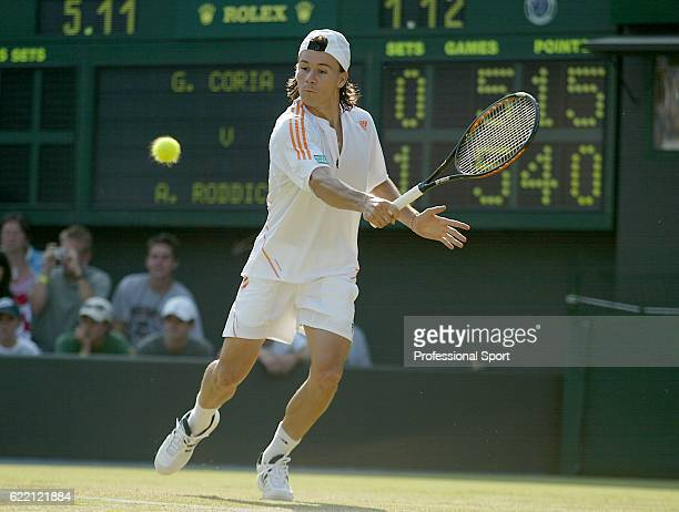 Guillermo Coria of Argentina in action against Tomas Behrend of Germany during the first round of the Wimbledon Lawn Tennis Championship on June 21,...