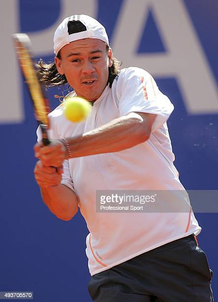 Guillermo Coria of Argentina plays a backhand against David Ferrer of Spain in their quarter final match during the ATP Masters Series at the Monte...